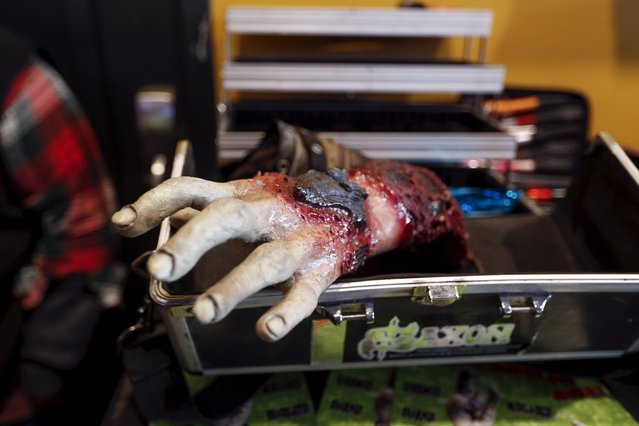 A fake hand is seen in the case of a makeup artist during the NYC Zombie Crawl in New York, October 18, 2015. (Photo by Shannon Stapleton/Reuters)