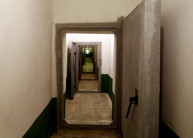 A long corridor is seen at a bunker, built by late communist dictator Enver Hoxha in Tirana, on Saturday, November 22, 2014. A gigantic, secret underground bunker that Albania's communist regime built in the 1970s to survive a nuclear attack by the Soviet Union or the United States has been opened to the public for the first time. (Photo by Hektor Pustina/AP Photo)