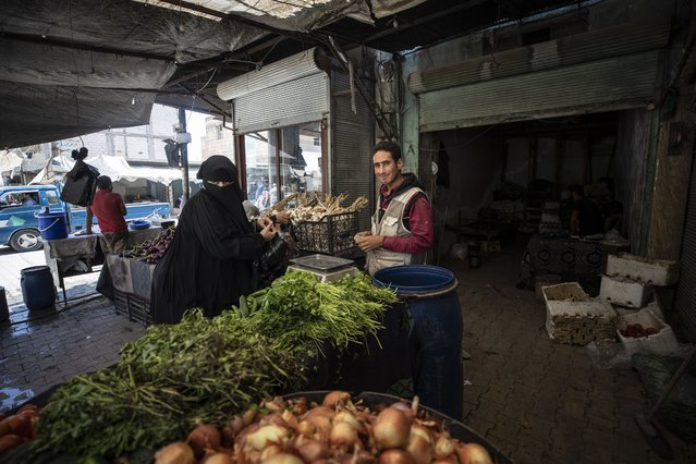 A fruit seller is seen in town center in Syria's Jarabulus, which was liberated from terrorists within the Operation Euphrates Shield, on August 13, 2020. Syrian shopkeepers in Jarabulus lead a normal life in peace as they continue to work in the shops in the central market. (Photo by Esra Hacioglu/Anadolu Agency via Getty Images)