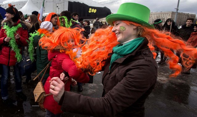 People dance during a St. Patrick's Day Parade in Moscow, on March 16, 2013. (Photo by Misha Japaridze/Associated Press)