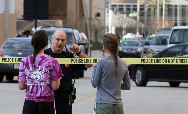 University of Central Florida students inquire at police lines, Monday, March 18, 2013, in Orlando, after a person was found dead on campus from what appeared to be a self-inflicted gunshot wound. (Photo by Red Huber/Orlando Sentinel/MCT)