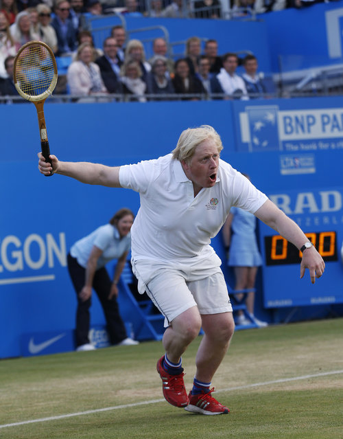 London Mayor Boris Johnson takes part in a charity game of tennis at the Queen's Club in west London June 16, 2013. (Photo by Eddie Keogh/Reuters)