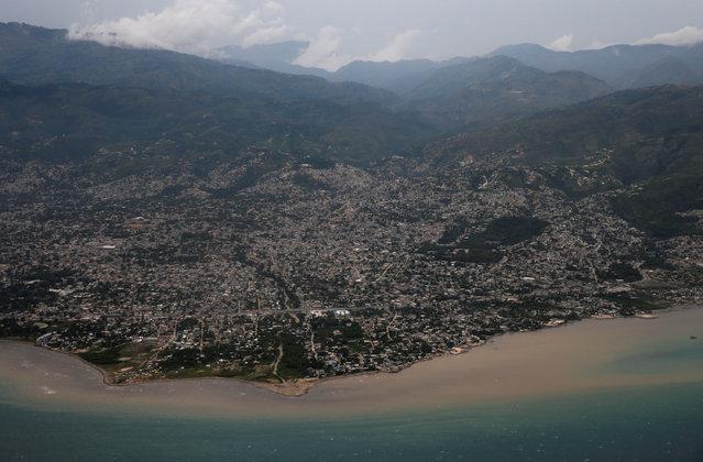 An aerial view as Hurricane Matthew approaches in Port-au-Prince, Haiti, October 2, 2016. (Photo by Carlos Garcia Rawlins/Reuters)