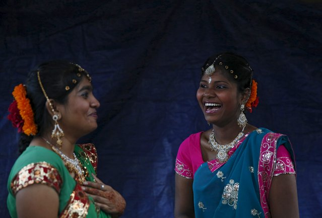 Dancers laugh before going on stage for a Diwali performance in Kuala Lumpur, Malaysia, October 28, 2015. (Photo by Olivia Harris/Reuters)