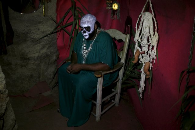 """A man dressed as an African shaman performs in the second edition of """"Noche del Terror"""" (Horror night) during Halloween celebrations in the neighborhood of Churriana, near Malaga, southern Spain, October 31, 2015. (Photo by Jon Nazca/Reuters)"""
