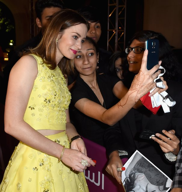 Emily Blunt poses with fans as she attends the Opening Night Gala during day one of the 11th Annual Dubai International Film Festival held at the Madinat Jumeriah Complex on December 10, 2014 in Dubai, United Arab Emirates. (Photo by Gareth Cattermole/Getty Images for DIFF)