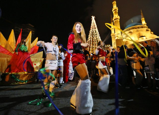 Dancers celebrate during a Christmas tree lighting in downtown Beirut December 20, 2014. (Photo by Jamal Saidi/Reuters)