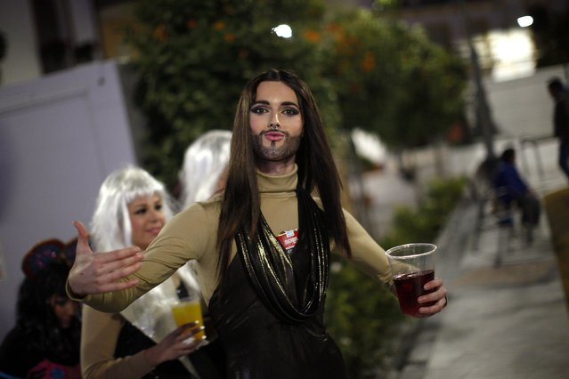 A reveller dressed up as Austrian drag queen and 2014 Eurovision song contest winner Conchita Wurst takes part in New Year's celebrations in Coin, near Malaga, southern Spain, early January 1, 2015. Villagers and revellers dressed up in funny costumes to take part in the New Year's celebration. (Photo by Jon Nazca/Reuters)