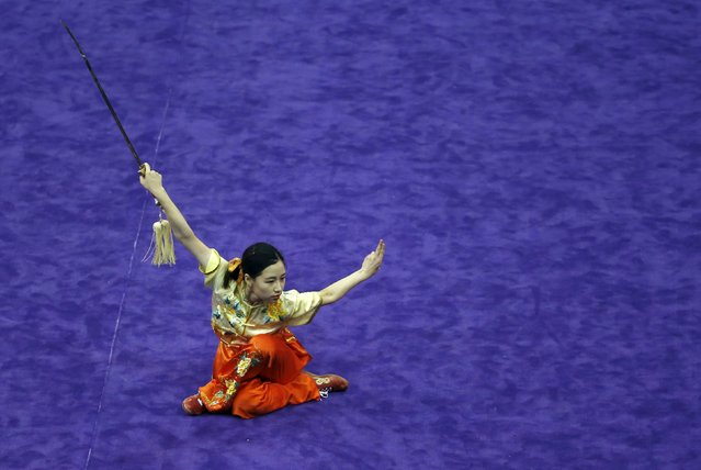 South Korea's Seo Hee-ju competes in the women's jianshu final during the 13th World Wushu Championship 2015 at Istora Senayan stadium in Jakarta, November 17, 2015. (Photo by Reuters/Beawiharta)