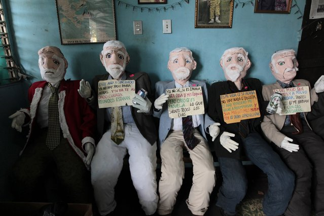 Handmade puppets are seen inside the home of Hector Villareyna, a craftsman from Leon city, in Managua December 27, 2014. Villareyna began making puppets from old clothes to be sold at 600 cordobas ($23) to represent the past year. In Nicaragua, puppets are burned traditionally as a way of saying goodbye to the old year and welcoming the new. (Photo by Oswaldo Rivas/Reuters)