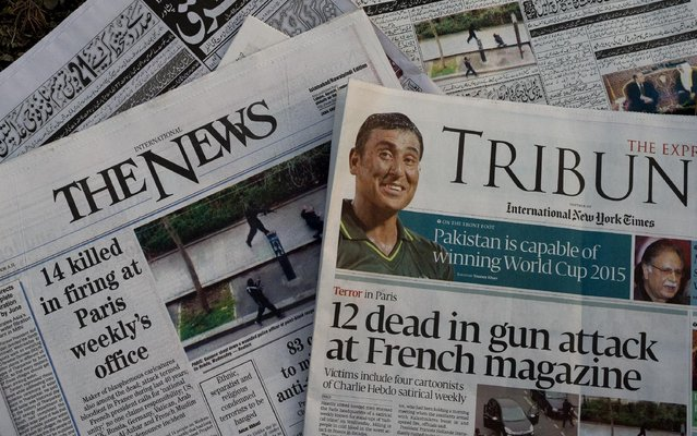 Pakistani newspapers carry headlines reporting about Wednesday's attack on a satirical newspaper in Paris, at a news stand in Islamabad, Pakistan, Thursday, January 8, 2015. Police hunted Thursday for two heavily armed men, one with possible links to al-Qaida, in the methodical killing of 12 people at the Charlie Hebdo that caricatured the Prophet Muhammed. (Photo by B. K. Bangash/AP Photo)