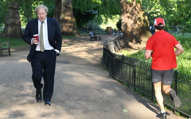 Prime Minister Boris Johnson takes a morning walk in St James's Park in London before returning to Downing Street on Wednesday May 6, 2020. (Photo by Stefan Rousseau/PA Images via Getty Images)