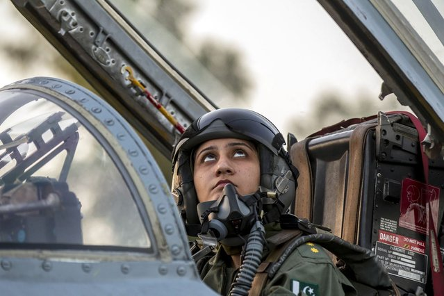 Ayesha Farooq, 26, Pakistan's only female war-ready fighter pilot, looks up as she closes the cockpit of a Chinese-made F-7PG fighter jet at Mushaf base in Sargodha, north Pakistan June 6, 2013. (Photo by Zohra Bensemra/Reuters)
