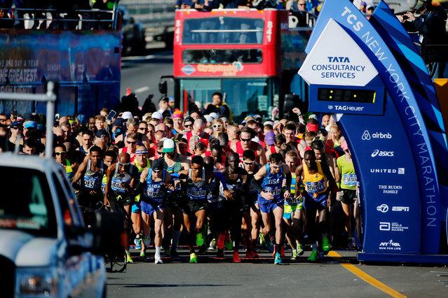 Men compete during the 2016 New York City Marathon in the Manhattan borough of New York City, U.S., November 6, 2016. (Photo by Eduardo Munoz/Reuters)