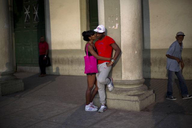 A couple waits for the bus in Havana, Cuba, Monday, January 19, 2015. (Photo by Ramon Espinosa/AP Photo)
