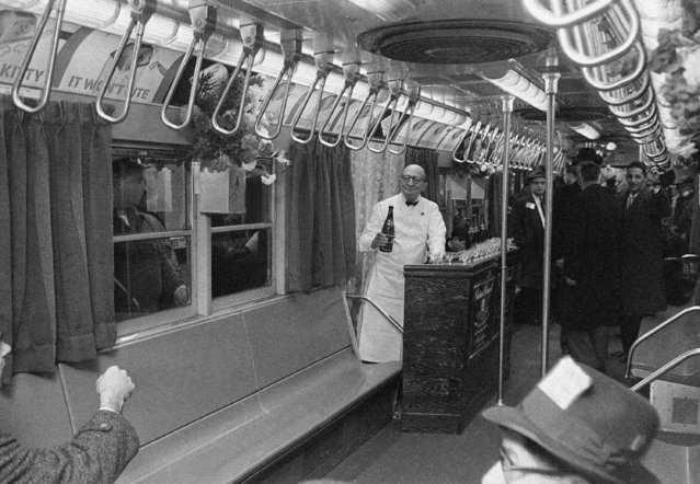 """Joseph E. O'Grady, right, member of New York City's Transit Authority, stands at bar installed temporarily in the Authority's """"dream car"""" in New York, January 17, 1962. The car, which had fresh flowers, carpeting, draperies and pastel lighting, made a special trip as part of a nine-car train on the city's subway lines from Times Square to South Ferry and back. (Photo by John Rooney/AP Photo)"""