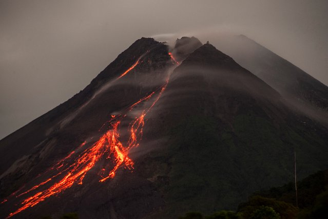 Lava flows down from the crater of Mount Merapi, Indonesia's most active volcano, as seen from Kaliurang in Yogyakarta on March 1, 2021. (Photo by Agung Supriyanto/AFP Photo)