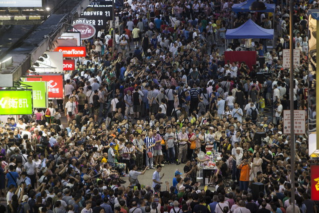 Thousands of people gathering to see buskers performances in Sai Yeung Choi Street South in Mongkok district, Hong Kong, China, 29 July 2018. (Photo by Jerome Favre/EPA/EFE)