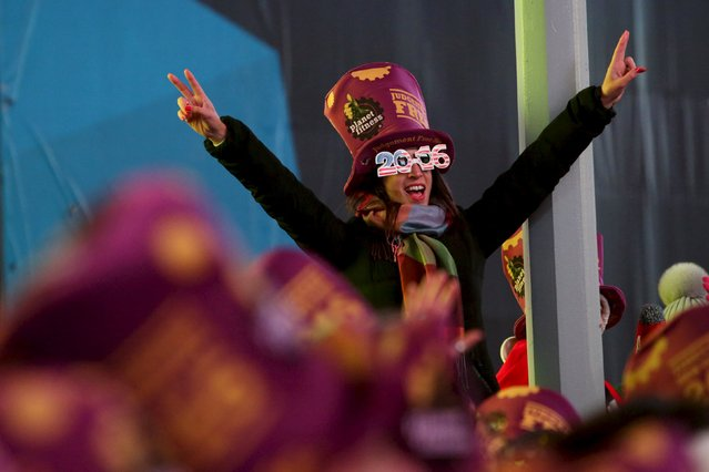 A woman cheers during New Year celebrations in Times Square in the Manhattan borough of New York December 31, 2015. (Photo by Andrew Kelly/Reuters)