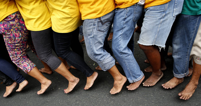 Barefooted devotees take part in a religious procession two days before the annual parade of the Black Nazarene in Manila, Philippines January 7, 2016. (Photo by Erik De Castro/Reuters)