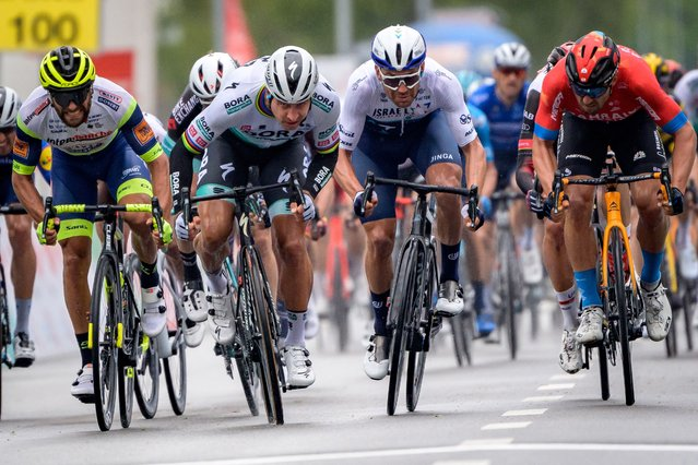 Peter Sagan of Slovakia (2ndL) sprints to win ahead of second-placed Sonny Colbrelli of Italy (FarR) and third-placed Patrick Bevin of New Zealand (2ndR) at the arrival of the stage 2, 168.1 km from Aigle to Martigny during the Tour de Romandie UCI World Tour 2021 cycling race in Martigny on April 28, 2021. (Photo by Fabrice Coffrini/AFP Photo)