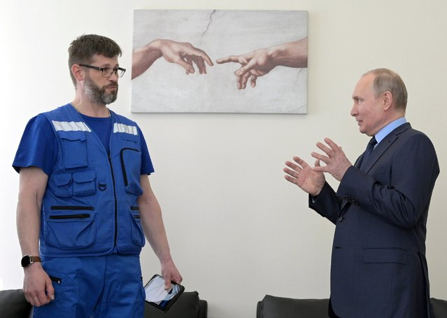 Russia's President Vladimir Putin visits an ambulance and emergency medical care station in the town of Pushkin, St Petersburg, Russia on April 28, 2021. On April 28, Russia celebrates Ambulance Worker Day. Pictured L is paramedic Mikhail Antonov. (Photo by Alexei Druzhinin/Russian Presidential Press and Information Office/TASS)