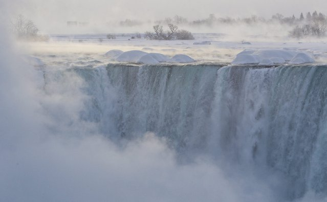 "Pieces of ice flow over the Canadian ""Horseshoe"" Falls in Niagara Falls, Ontario, Canada, Thursday, February 19, 2015. (Photo by Aaron Lynett/AP Photo/The Canadian Press)"