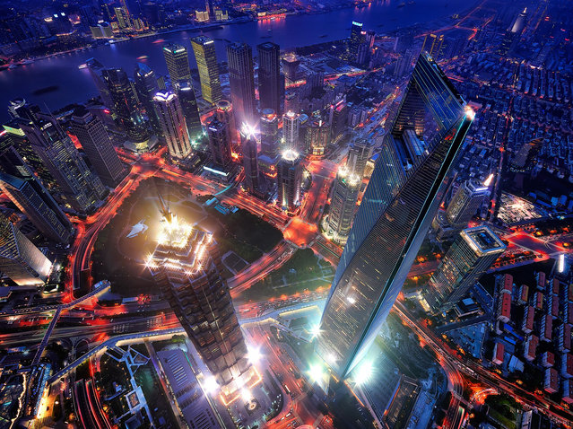 The view at night from the Shanghai Tower in Shanghai, China on August 7, 2015. The tower is technically smaller than the Burj Khalifa in Dubai but, while the observation deck of Dubai's mega-structure is at 556m, the Shanghai Tower's is at 561m, meaning the view is a little higher. (Photo by Paul Reiffer/REX Shutterstock)