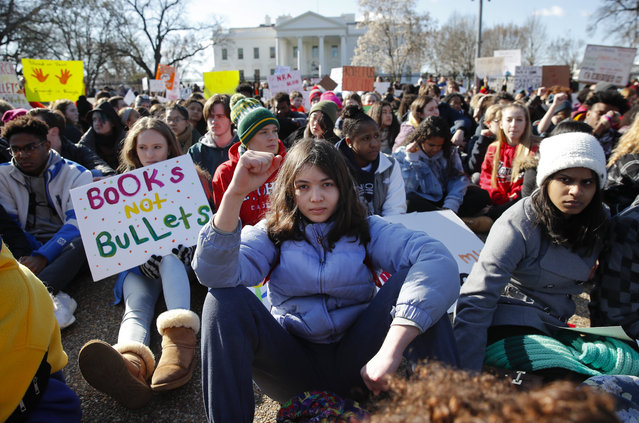 In this March 14, 2018, file photo, students rally in front of the White House in Washington. Students walked out of school to protest gun violence in the biggest demonstration yet of the student activism that has emerged in response to last month's massacre of 17 people at Florida's Marjory Stoneman Douglas High School. (Photo by Carolyn Kaster/AP Photo)