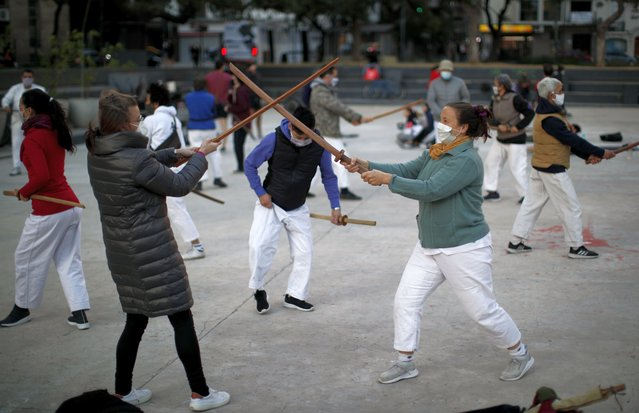 People practice aikido at a park amid the COVID-19 pandemic in Buenos Aires, Argentina, Wednesday, June 2, 2021. (Photo by Natacha Pisarenko/AP Photo)