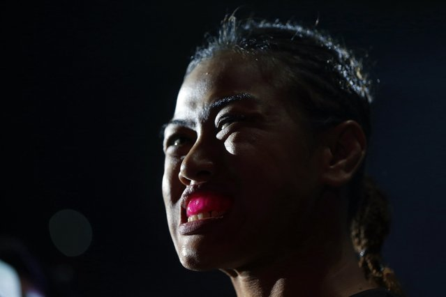 Malaysia's Ann Osman puts in her mouth guard before her mixed martial arts (MMA) ONE Championship fight against Egypt's Walaa Abbas in Kuala Lumpur, March 13, 2015. Osman is the first female Muslim MMA fighter to compete at the top level of the sport. (Photo by Olivia Harris/Reuters)