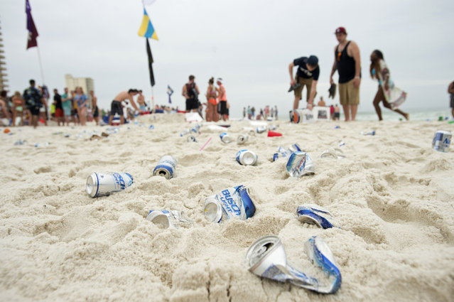 Empty beer cans litter the beach during spring break festivities in Panama City Beach, Florida March 12, 2015. (Photo by Michael Spooneybarger/Reuters)