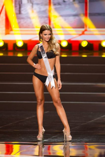A handout picture provided by the Miss Universe Organization shows Rebeka Karpati, Miss Hungary 2013, competing in the swimsuit competition during the Preliminary Competition at the Crocus City Hall, in Moscow, Russia, 05 November 2013. (Photo by Darren Decker/EPA)