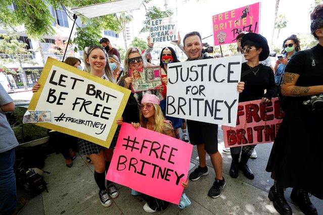 People protest in support of pop star Britney Spears on the day of a conservatorship case hearing at Stanley Mosk Courthouse in Los Angeles, California, U.S. June 23, 2021. (Photo by Mario Anzuoni/Reuters)