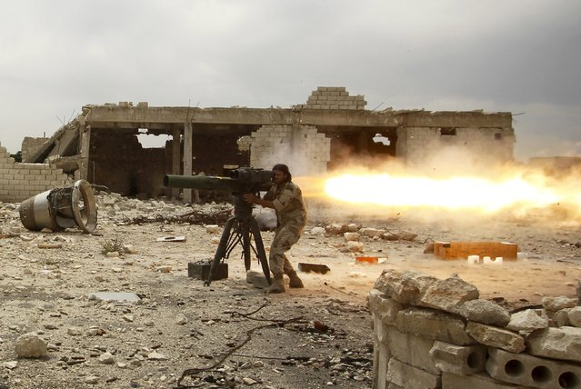 A rebel fighter of 'Al-Sultan Murad' brigade fires an anti-tank missile towards forces loyal to Syria's President Bashar al-Assad near Aleppo's international airport May 9, 2015. (Photo by Rami Zayat/Reuters)