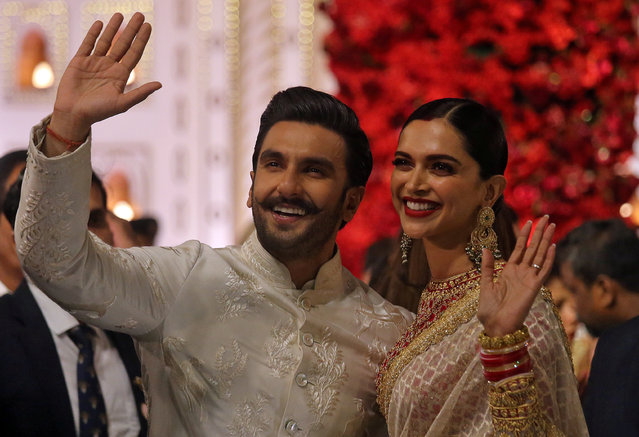 Bollywood actor Ranveer Singh and his wife actress Deepika Padukone leave after attending the wedding ceremony of Isha Ambani, the daughter of the Chairman of Reliance Industries Mukesh Ambani, in Mumbai, India, December 12, 2018. (Photo by Francis Mascarenhas/Reuters)
