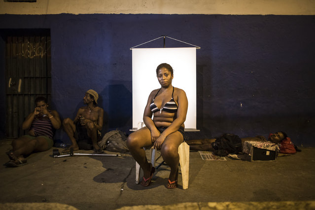 "In this March 14, 2015 photo, Valeria de Brito, 36, poses for a portrait in an open-air crack cocaine market, known as a ""cracolandia"" or crackland where users can buy crack, and smoke it in plain sight, day or night, in Rio de Janeiro, Brazil. Brito, who has been using crack for over 8 years says she does not like the crackland environment, that she prefers to use drugs elsewhere. (Photo by Felipe Dana/AP Photo)"