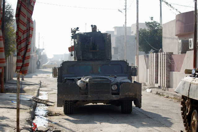 A military vehicle of the Iraqi rapid response forces is seen during battle with Islamic State militants in the Mithaq district of eastern Mosul, Iraq, January 5, 2017. (Photo by Khalid al Mousily/Reuters)