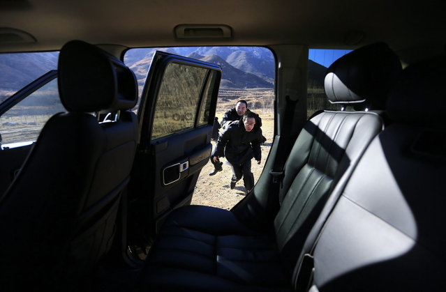 Trainees practice helping their employer escape into a car at a shooting training field managed by the military during the Tianjiao Special Guard/Security Consultant training on the outskirts of Beijing December 14, 2013. (Photo by Jason Lee/Reuters)