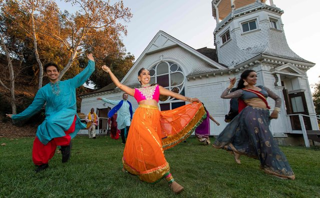 Blue13 Dance Company dancers perform during the dress rehearsal for Shaadi (Hindi for wedding), an outdoor contemporary and Bollywood dance event at the Heritage Square Museum in Los Angeles on September 16, 2021. (Photo by Valerie Macon/AFP Photo)