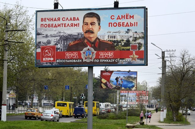 "A billboard reading ""Eternal glory to the victors""  sponsored by the Communist Party, which has always praised Stalin's role in the defeat of Nazi Germany is seen in a street in Sevastopol, Thursday, April 30, 2015. Billboards with the image of Soviet dictator Josef Stalin have appeared all over Sevastopol in Russian-annexed Crimea in the run-up to Victory Day celebrations on May 9. (Photo by Anton Volk/AP Photo)"