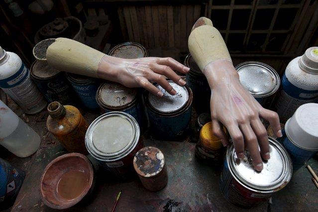 A set of wooden hands is seen at Jose Sabas Gomez's workshop in Apastepeque, El Salvador March 9, 2016. (Photo by Jose Cabezas/Reuters)