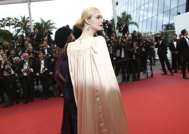 "Jury member Elle Fanning poses for photographers upon arrival at the opening ceremony and the premiere of the film ""The Dead Don't Die"" at the 72nd international film festival, Cannes, southern France, Tuesday, May 14, 2019. (Photo by Joel C Ryan/Invision/AP Photo)"