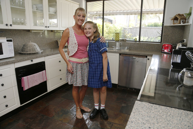 Kylie Glass, 40, and her daughter Abby Glass, 12, pose for a picture in Caringbah, Sydney February 18, 2014. Kylie finished school at age 17 and now has a job training childcarers. She says that when she was growing up, she wanted to work with children. Kylie says she just wants her daughter to be healthy and happy. Abby says that she enjoys anything to do with science so might want to be a forensic policewoman or else do something completely different like become a hairdresser. (Photo by Jason Reed/Reuters)