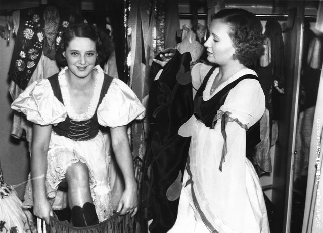 Dancers of the Blue Train cabaret troupe get into their costumes for a performance at the Prince of Wales Theatre in London