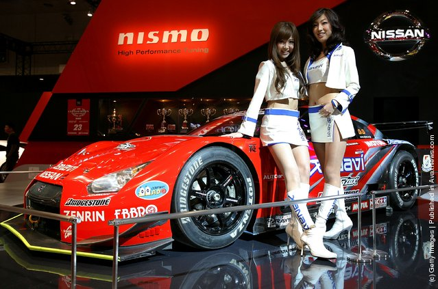 Model poses with Nissan Xanavi Nismo GT-R at a booth at Tokyo Auto Salon 2009