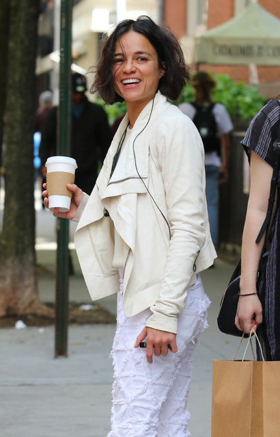 Michelle Rodriguez is all smiles while having her morning coffee in Manhattan's Soho area on May 16, 2019. (Photo by Joker/Splash News and Pictures)