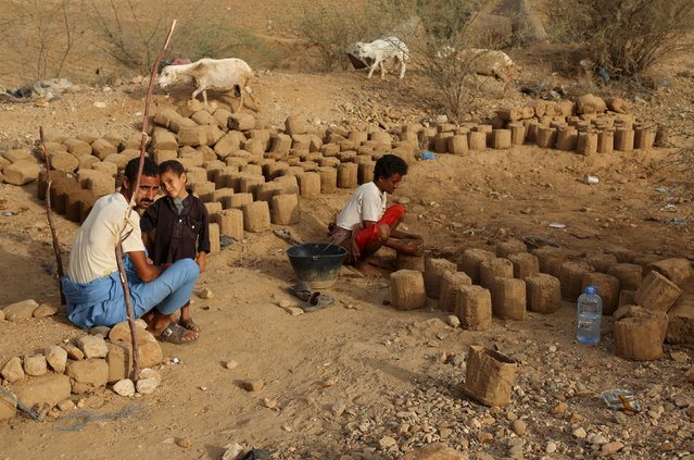 People prepare mud bricks to build a hut at the Shawqaba camp for internally displaced people who were forced to leave their villages by the war in Yemen's northwestern province of Hajjah March 12, 2016. (Photo by Abduljabbar Zeyad/Reuters)