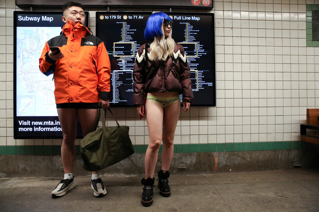 """People participate in the annual """"No Pants Subway Ride"""" in the Manhattan borough of New York City, U.S., January 13, 2019. (Photo by Caitlin Ochs/Reuters)"""