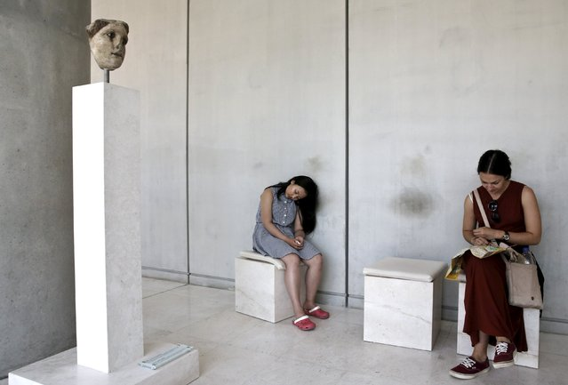 A visitor (C) rests at the Acropolis museum in Athens May 18, 2015. Museums across Greece offered free admission to visitors on Monday to celebrate International Museum Day. (Photo by Alkis Konstantinidis/Reuters)